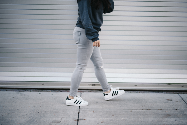 grey jeans adidas sneakers